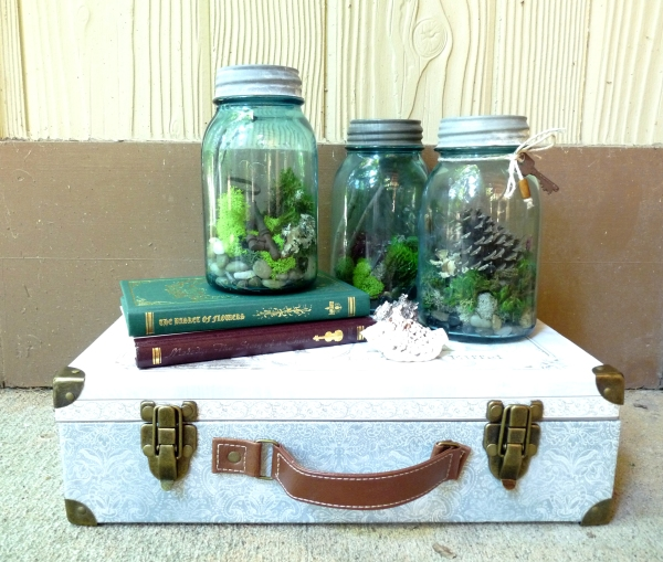 rustic handmade mason jar terrariums with moss and antique keys