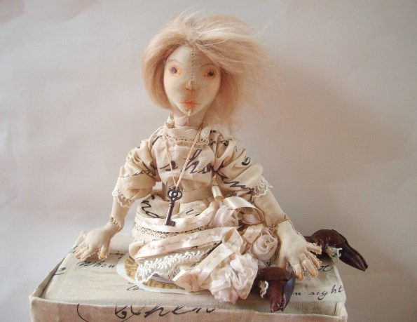 textile art doll in creams and peaches by the free folk