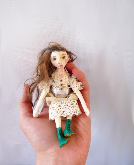 A finished mini doll: Sculpted, painted, sealed, strung, and dressed!
