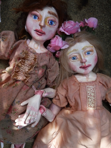 two jointed Paperclay dolls