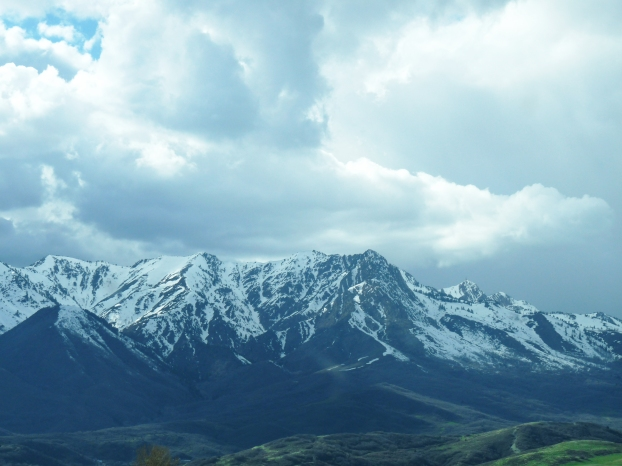 landcape photography of dramatic clouds above a ridge of the rockies