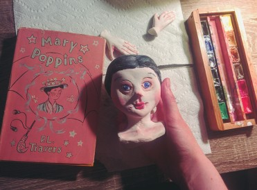 painting a paperclay art doll head of mary poppins