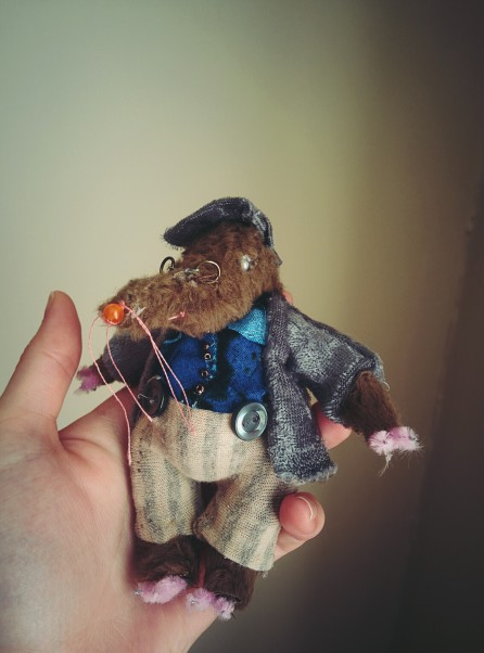 a miniature cloth doll based on the character of mole from the wind in the willows