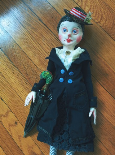 a paperclay and cloth art doll based on the character of mary poppins