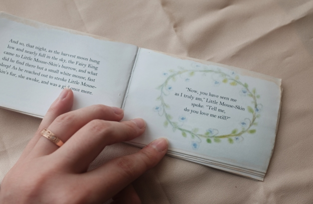 miniature illustrated fairy tale book with flowers and vines