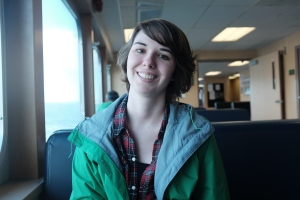 portrait photography of a smiling woman on the ferry to seattle WA