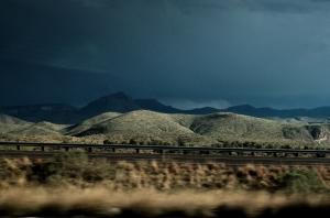 high-contrast lighting image of a desert thunderstorm