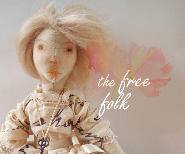 vintage art doll with spring flowers and the free folk logo