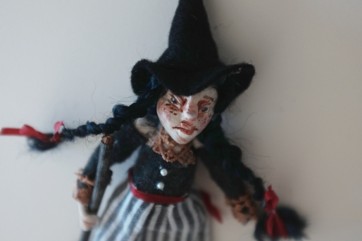 spooky miniature handmade witch doll for halloween
