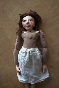shows the final stage in making a cloth and paperclay art doll