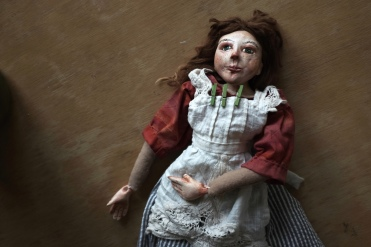 Victorian art doll with a cloth body and paperclay head and hands