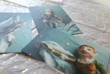 desk in soft blues and gold stars showing three postcards with images of peter pan