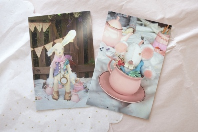 two postcards showing scenes from The Mad Tea Party from Alice in Wonderland