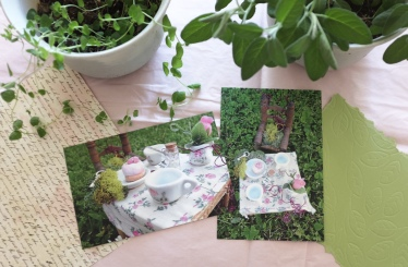 pink and green postcards and letters showing a miniature fairy tea party scene