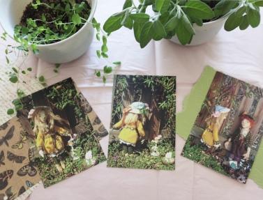 desk with vintage letters and soft pastels, including postcards of the secret garden