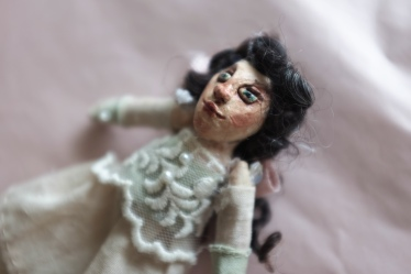 detail of a miniature art doll sculpted from paperclay
