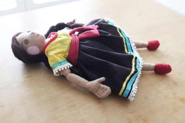 handcrafted cloth doll for children of a girl from Mexico with a detailed dress