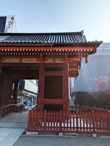 red pagoda in the middle of the city in Tokyo, surrounded by fog