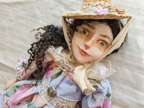 art doll in historic regency costume of blue silk and lace dress and straw hat