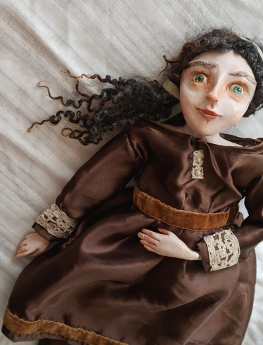 jointed art doll sculpted from paperclay, in a brown silk dress