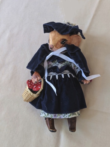 mouse art doll wearing a Victorian velvet cape and bonnet and carrying a basket filled with mushrooms