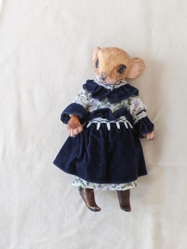 anthropomorphic mouse doll in a blue Victorian dress