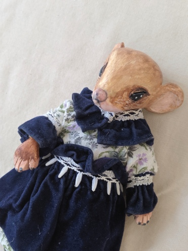 close-up of anthropomorphic miniature mouse art doll in Victorian dress